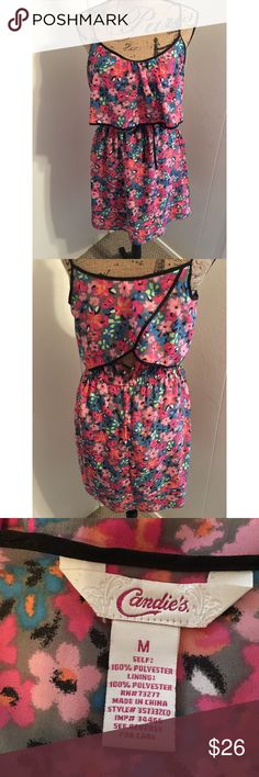Adorable dress with open back This floral dress is SO cute! The back has 2 flaps with a small opening under them. Flawless condition! Candie's Dresses
