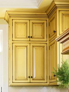 love these yellow glazed cabinets.  pretty sure i love this.  wondering how much work it is?  wouldnt work on any of the cabinets i now have access to anyway.
