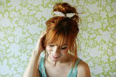 messy high bun with bow