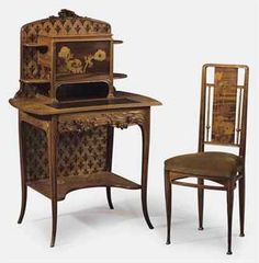 LOUIS MAJORELLE (1859-1926). A CARVED AND INLAID WALNUT, AMARANTH AND FRUITWOOD BONHEUR DU JOUR, CIRCA 1905