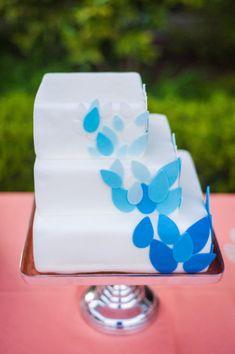 Asymmetrical blue cake. Dress My Cupcake. Photography by azellephotography.com, Event Design by morgangalloevents.com, Floral Design by kiwifleur.com