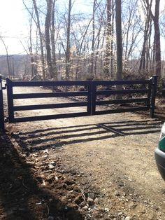 Wood 4-Rail Post and Rail Automated Driveway Gate