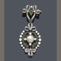 An early 20th century diamond, emerald and pearl pendant/brooch,