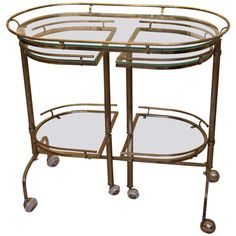 1950s Mid-Century Modern Italian Bar Cart in Brass | From a unique collection of antique and modern bar carts at http://www.1stdibs.com/furniture/tables/bar-carts/