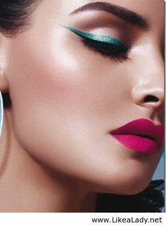 Green eyeliner and fuchsia lips