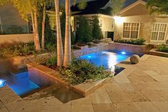 Planters filled with palms, jasmine and bouganvillea add to the pool's natural ambience.