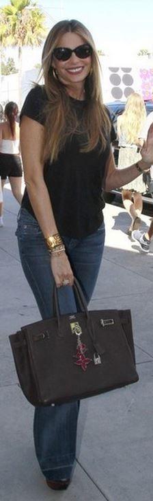 Sofía Vergara: Bracelet and purse – Hermes  Jeans – Hudson  Charm – Louis Vuitton