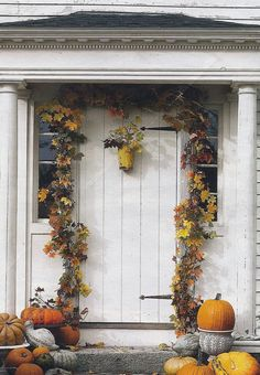 Double up store bought garlands of silk leaves so you have a thicker than usual border around the door. Add small branches of the real leaves pushed into the garland to bring it life.  Place a grouping of pumpkins and large gourds on the stoop.