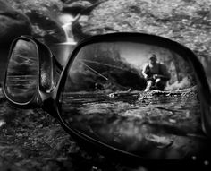 This a composite of 3 images.  The sunglasses and foreground where taken with an iPhone 4 at extreme close-up.  The reflection was with a Canon 5D with a Canon 17-40 at the wide end. I put the camera in a fish tank and submerged it about 4 inches in the stream then had the fly fisher cast toward me as I remotely popped several frames.  For the background I use a Canon 200mm to get some compression.    Hand blended in CS5, mono conversion using NIk Silver X-pro, and then into LS5 for minor…