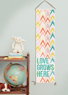 Love Grows Here girl's canvas growth chart.  Pink, yellow, turquoise, coral.