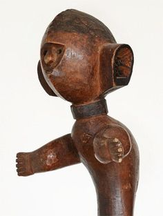 A wonderfully dynamic male Hehe figure. The carver has successfully used the shape of the wood to produce a sculpture with extarordinary grace and movement. The face is small, enclosed in a triangu...