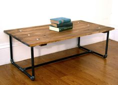 Rustic style coffee table with metal pipe frame and exposed bolts. $260.00, via Etsy.