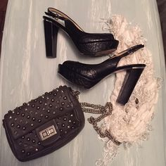 Marc Fisher Heels Black Peep toe heels with snake print. Slight damage only on the inside of both shoes. Shown on the last pic. Marc Fisher Shoes Platforms