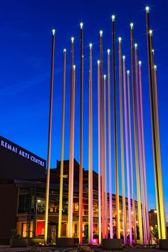 The Prairie Wind landmark consists of 25 15m-tall steel poles, each on a rubber bearing pad. This allows the poles to sway in the wind, giving the impression of prairie grass. Sixteen LED floodlights illuminate the landmark from the base, and can be programmed to change colour.