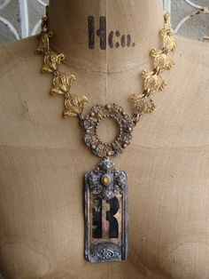 """Your Royal Majesty Necklace  $175.00  Vintage """"R"""" Alphabet Brass Stencil  Vintage cross with yellow stone, filigree, Tin Type of handsome young man, vintage filigree circle, gorgeous filigree gold chain.  www.parispanacheantiques.com"""