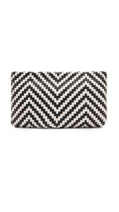 I am obsessed with this woven leather black-and-white Christopher Kon Alisson Clutch...but hate that it's made in China. Need to find a better option!