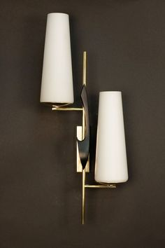 Pair of 1950s Asymmetrical Sconces by Maison Arlus | From a unique collection of antique and modern wall lights and sconces at https://www.1stdibs.com/furniture/lighting/sconces-wall-lights/