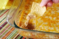 Texas Trash   1 package cream cheese  1 cup sour cream  2 cans (16 ounces, each) refried beans  1 packet taco seasoning  2 cups cheddar cheese, shredded  2 cups monterey jack cheese, shredded.   A definite must try!