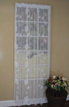 Curtain Chic Seashells Lace Panel, 84-Inch, White Curtain Chic, Inc. http://www.amazon.com/dp/B00H6ZCTFG/ref=cm_sw_r_pi_dp_lwIStb11A4A0KRJG