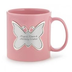 Personalized Pink Butterfly Mug  $15  Butterflies are a symbol of a long life and of bliss, making this just the right gift for anyone in your life you wish to be around forever. Engrave her name and a message on the butterfly, and this will become the mug she reaches for every morning as the coffee begins percolating.