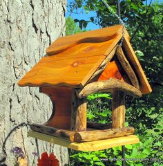Wooden bird feeder bird house combo functional by MyRetirementGig, This Tiverton features driftwood for the gable design. The driftwood was captured from the Upper Niagara river before it tumbled over the Falls and on to Lake Ontario.