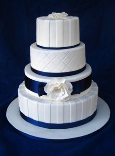 """Navy & White Wedding Cake - Chocolate and white chocolate layered mud cake. The 2nd tier is a dummy. 12"""", 10"""", 8"""" & 6"""" round cakes."""
