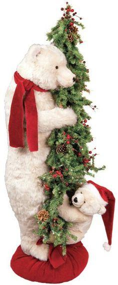 is a Christmas Bear hugging a tree!