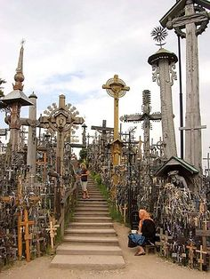 The Hill of Crosses is a site of pilgrimage near Šiauliai, Lithuania. Over the centuries, Catholic pilgrims have left behind not only crosses, but giant crucifixes, carvings of Lithuanian patriots, statues of the Virgin Mary and thousands of rosaries. The exact number of crosses is unknown, but estimates put it at about 100,000 in 2006.