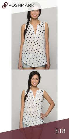 Sweet Thing White And Navy Polka Dot Top Cute white and navy polka dot sleeveless top! Model is wearing a size Small Tops Tank Tops