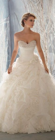 Stunning, organza ruffled bottom, ball gown style, wedding dress with beaded sweetheart neckline.