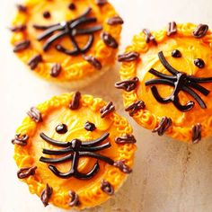 Smiling Lion Cupcakes--Everyone will roar with delight when these birthday cupcakes appear. You only need orange and brown frosting, black licorice, and black icing gel to make this pride of lions.