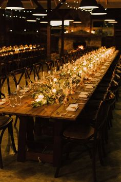 Rustic country wedding reception table with natural greenery and votive candles   Sophie Baker Photography