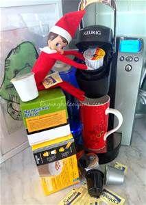 Shelf elfie gets his own hot beverage from a Keurig coffee maker.