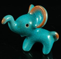 Walter Bosse for Karlsruhe Ceramic (Austria) elephant (1956-1962). Turquoise blue majolica glaze over red brick clay.