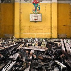 A basketball hall in a German military camp. The painting on the wall hints that this was used during the Nazi olympics of 1936 © Darren Nisbett