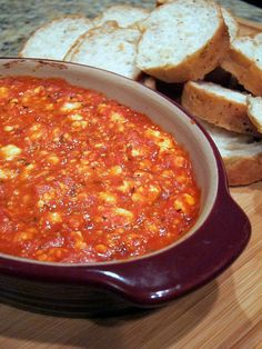 BAKED FETA: 6 oz crumbled feta  3/4 cup pizza sauce  1/4 tsp red pepper flakes (or more if you want it spicier)  16 oz french bread loaf, sliced    Preheat oven to 350.  Combine feta, pizza sauce and red pepper flakes in a bowl.  Transfer mixture to a small gratin dish or shallow baking dish.  Bake for 20 minutes or until bubbly.  Serve with sliced french bread.