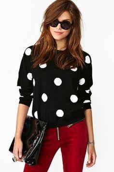 Women's Black Sunglasses, Black and White Polka Dot Crew-neck Sweater, Black Leather Clutch, and Burgundy Skinny Pants
