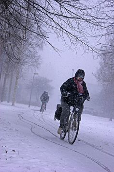 Riding a bike through the snow - I saw this in Belgium where many ride bikes in lieu of driving cars. Cheers!