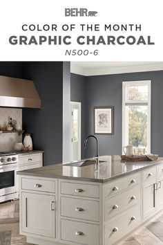 This kitchen features a traditional interior design style with a modern twist. The Behr paint Color of the Month, Graphic Charcoal, is the finishing touch. A dark and dramatic shade of gray, this wall color complements the neutral granite countertop, wood floor, and white tile backsplash in this space. Click below to discover more color inspiration.