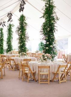 Great idea to decorate the poles • Bringing Garden elements inside a Marquee