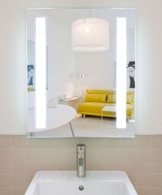 Fusion Lighted Mirror backlit mirror and comes in six standard sizes and has two bands of vertical frosted light on the left and right sides Backlit Mirror, Led Mirror, Mirror With Lights, Lighted Mirror, Wall Mirror, Cool Lighting, Modern Lighting, Led Bathroom Lights, Electric Mirror