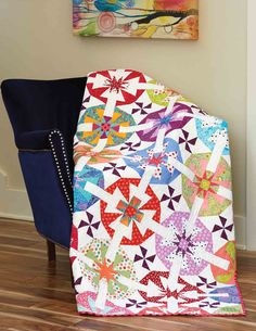 There's a lot to love about Fairy Floss by Janna Thomas! The original and complex block design is further enhanced by pieced sashing. Wow! Bloc Loc tools ensure accuracy in this colorful scrappy throw quilt pattern.