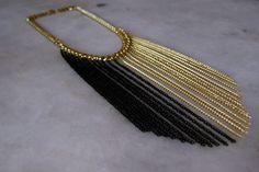 Colar correntes dourado e preto R$45,00