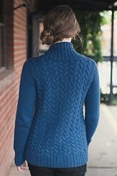The Tullamore Pullover is subtle and smart. The chainette structure of Woolfolk Får's ultra merino creates undulating cables that seem to rise out of and fade into the fabric. This inviting pullover is worked in the round from the bottom up and then split at the armholes. The sleeves and turtleneck are picked up and knitted for seamless, simple finishing.
