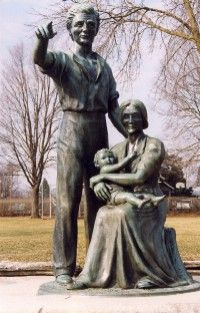 The Pioneers sculptrue - Clarence Shaler created this young family out of respect for the optimism that helped his parents and other settlers to forge ahead in the untamed wilderness of America.  The Pioneers has become a well loved landmark of Waupun's Wilcox Park since 1940 when it was placed at this site.  Shaler sculpted this piece in memory of his mother's steadfast dedication to her family and the toilsome pioneer lifestyle.  LOCATION:  Wilcox Park, corner of Watertown and Lincoln…