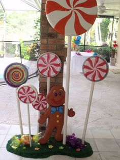candy land decorations for life size game (staple paper plates together, glue swirl printout, cellophane over it? Christmas Float Ideas, Candy Land Christmas, Christmas Yard, Grinch Christmas, Christmas Gingerbread, Outdoor Christmas, Xmas, Office Christmas Decorations, Candy Decorations