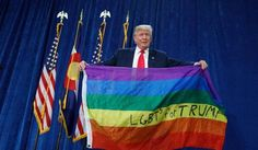 Republican presidential nominee Donald Trump holds a rainbow flag in support of the LGBT community during a rally at the University of Northern Colorado on Oct. 29. (Colorado Log Cabin Republicans)