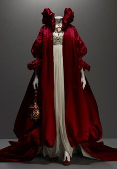 Alexander McQueen, Coat of red silk satin; dress of ivory silk chiffon embroidered with crystal beads, Fall, 2008.