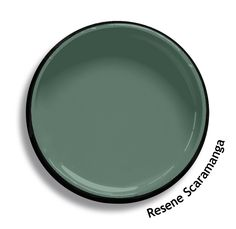 Resene Scaramanga is a sombre and muted slate green, imprinted with the warm undertone of ochre. Try Resene Scaramanga with ancient beiges, waxy ochre creams and spicy reds, such as Resene Moscato, Resene Oscar and Resene Jalapeno. From the Resene The Range fashion colours. Latest trends available from www.resene.com. Try a Resene testpot or view a physical sample at your Resene ColorShop or Reseller before making your final colour choice.