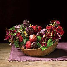 Dark and Dramatic Arrangement: Coleus foliage + bush ivy + artichokes + pomegranates + red spray roses + hellebores